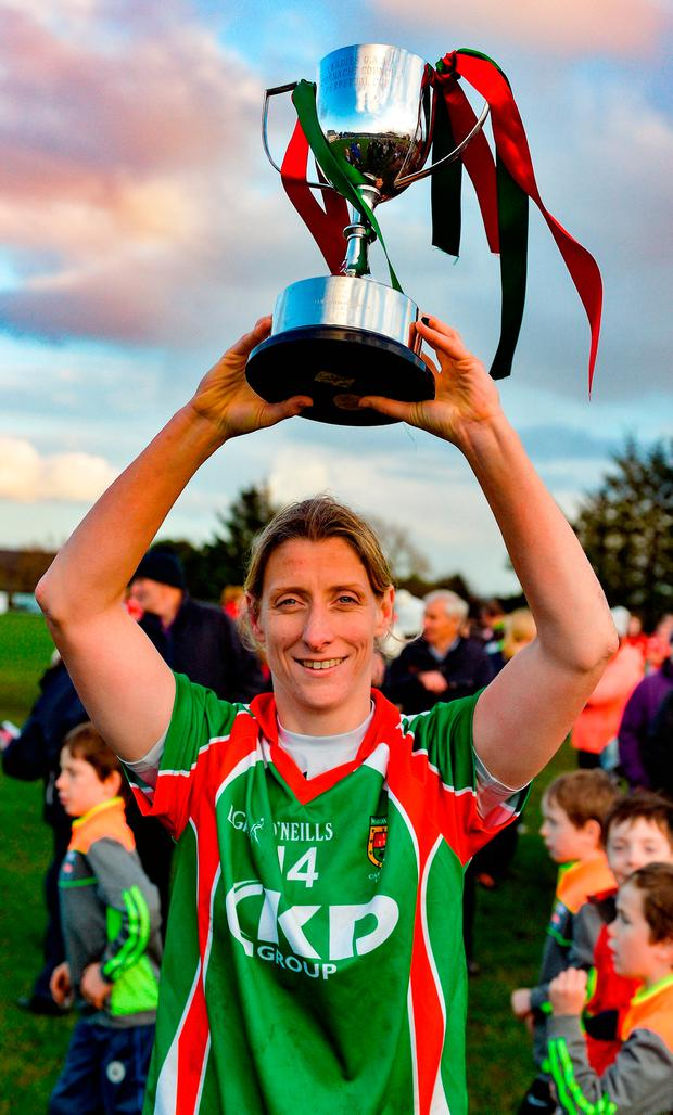 Cora Staunton lifts the cup after Carnacon's victory in the Connacht Ladies Football senior club final replay. Photo by Oliver McVeigh/Sportsfile