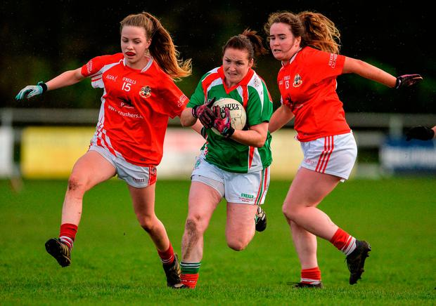 Michelle McGing of Carnacon in action against Hannah Noon and Nicola Ward of Kilkerrin-Clonberne. Photo by Oliver McVeigh/Sportsfile