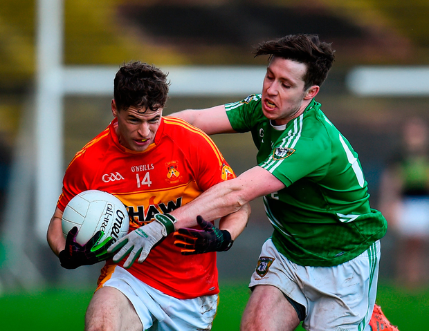 Castlebar's Neil Douglas is tackled by Mohill's Alan McLoughlin. Photo by Seb Daly/Sportsfile