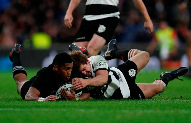 Barbarians' Kwagga Smith and New Zealand's Waisake Naholo in action. Photo: Reuters/Matthew Childs