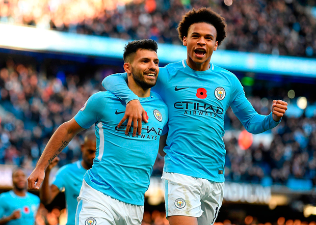 Sergio Aguero is congratulated by Leroy Sane after scoring Manchester City's second goal. Photo: Getty Images