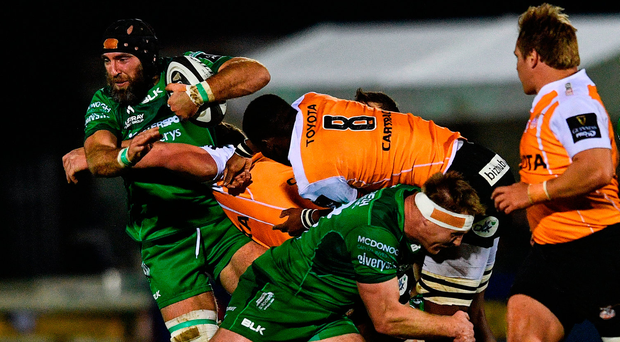 There's no quarter asked or given as Connacht's John Muldoon is tackled by Junior Pokomela of Cheetahs during Saturday night's clash in the Sportsground. Photo by Ramsey Cardy/Sportsfile