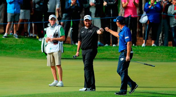 Pádraig Harrington is congratulated by Shane Lowry after chipping in on the 10th hole during the final round of the Turkish Airlines Open at the Regnum Carya Golf & Spa Resort in Antalya. Photo by Warren Little/Getty Images