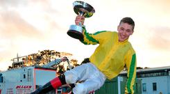 Colin Keane celebrates after being presented withe the Champion Jockey trophy at Naas. Photo: Healy Racing
