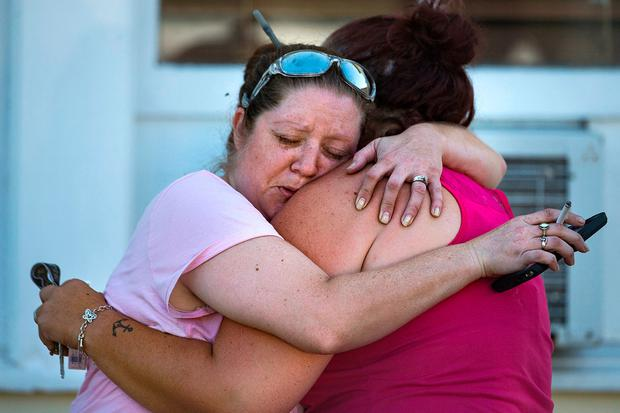 Women embrace at the scene of the killings in Sutherland Springs. Photo: AP