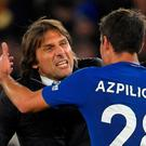 Chelsea manager Antonio Conte celebrates after the match with Cesar Azpilicueta