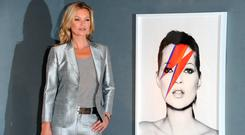 Kate Moss poses at a photocall ahead of the 'Kate Moss: The Collection' auction which sees various artworks of the model curated by Gert Elfering go under the hammer at Christie's King Street on September 4, 2013 in London, England. (Photo by Stuart C. Wilson/Getty Images)