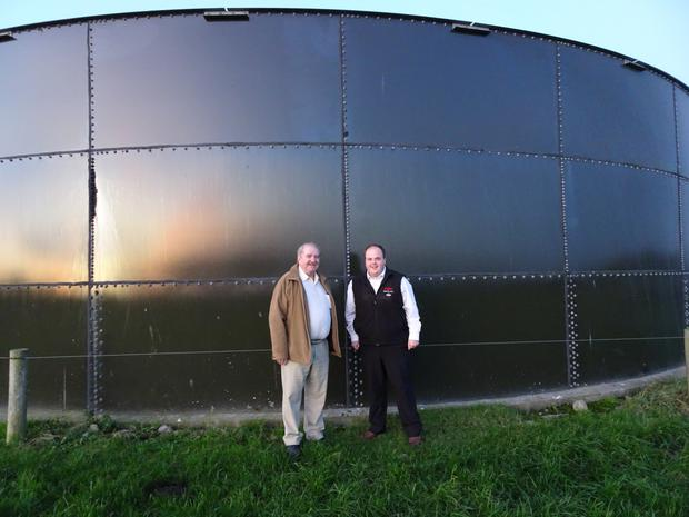Cllrs Kevin Sheahan and Adam Teskey at one of the affected farmer's slurry towers in County Limerick