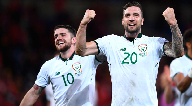 Shane Duffy celebrates alongside Robbie Brady after a towering performance in Ireland's victory over Wales. Photo: Stephen McCarthy/Sportsfile