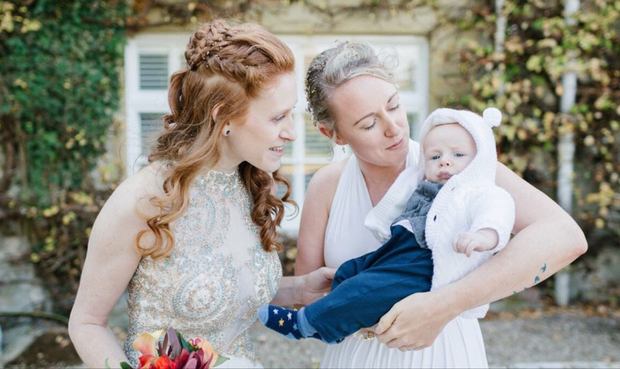 Katie (right) and Holly with Griffin on their wedding day