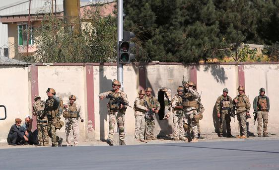 Afghan security personnel arrive at the Shamshad TV building after an attack in Kabul, Afghanistan, Tuesday, Nov. 7, 2017. Police officer Jan Agha says three people including a suicide bomber attacked the TV station. (AP Photo/Rahmat Gul)