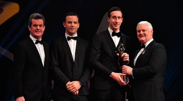 yrone footballer Colm Cavanagh is presented with his PwC All Star award from Uachtarán Chumann Lúthchleas Gael Aogán Ó Fearghail, in the company of Feargal O'Rourke, left, Managing Partner, PwC, and David Collins, GPA President during the PwC All Stars 2017 at the Convention Centre in Dublin. Photo by Brendan Moran/Sportsfile