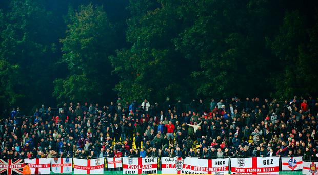 The travelling England fans show their support during the UEFA EURO 2016 qualifying Group E match between Lithuania and England at LFF Stadionas on October 12, 2015 in Kaunas, Lithuania. (Photo by Alex Livesey/Getty Images)