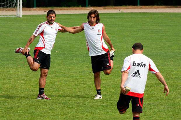 Gennaro Gattuso (L), Andrea Pirlo and Cristian Brocchi stretch during a training session ahead of next week's UEFA Champions League Final against Liverpool during the AC Milan Media Day at Milanello on May 16, 2007 in Carnago, Italy. (Photo Giuseppe Cacace/Getty Images)