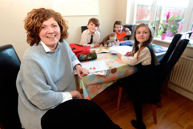There for the cuts and bruises: Deirdre Kelly with her kids Fionn (7), Sabha (5) and Ruadhan (3) Photo: Justin Farrelly