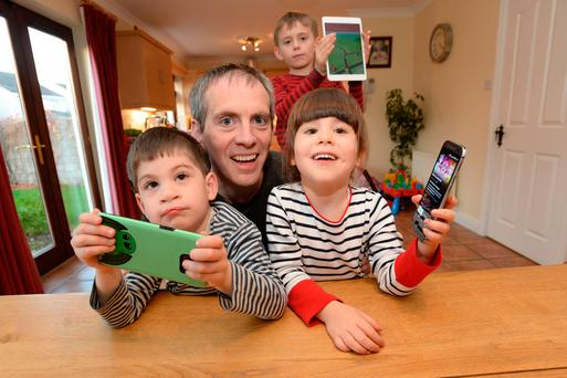 Off screen: Ed Power with his kids Niall (7) and twins Fiona and Cathal (4) Photo: Justin Farrelly
