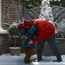 Paddington bear hugs the burglar in the M&S Christmas ad
