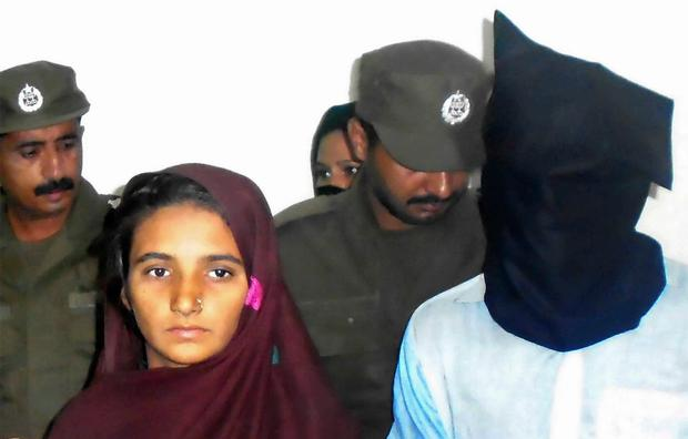 Aasia Bibi and her boyfriend, Shahid Lashari, are presented to journalists, at police station in Muzaffargarh in Pakistan (AP Photo/Iram Asim)