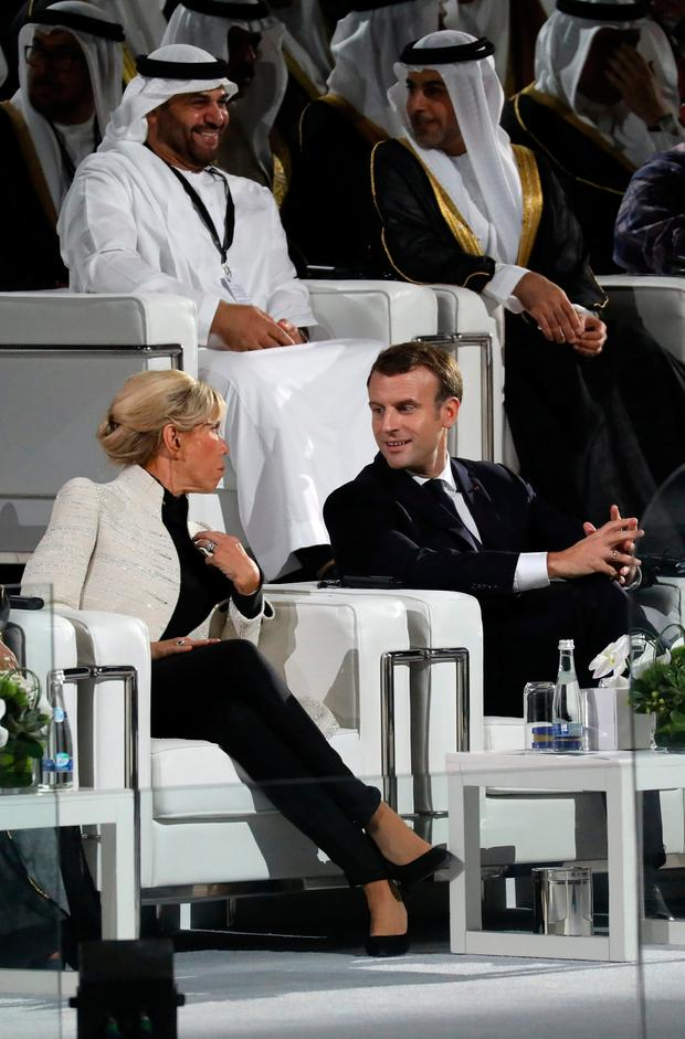 French President Emmanuel Macron and his wife Brigitte Macron attend the inauguration of the Louvre Abu Dhabi Museum in Abu Dhabi, UEA, November 8, 2017. REUTERS/Ludovic Marin/Pool
