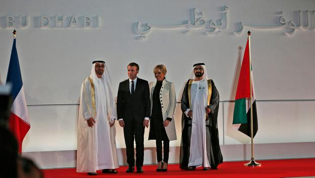 French President Emmanuel Macron, second left, with his wife, Brigitte, are received by Abu Dhabi Crown Prince Mohammed bin Zayed al-Nahayan, left, and Dubai's ruler Sheikh Mohammed bin Rashid Al Maktoum, at the official opening of Louvre Abu Dhabi museum, Wednesday, Nov. 8, 2017, in Abu Dhabi, United Arab Emirates. (AP Photo/Kamran Jebreili)