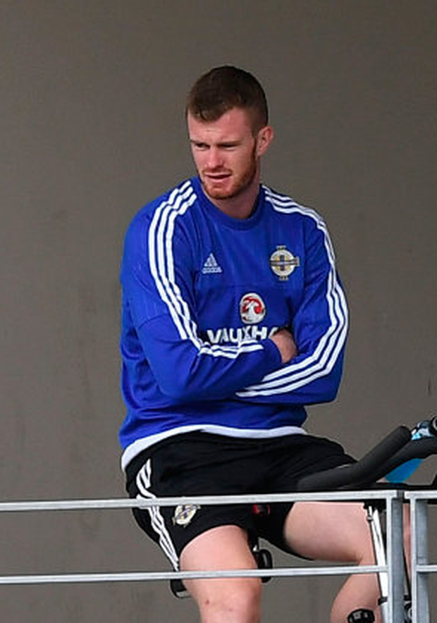 Chris Brunt was forced to watch on as his Northern Ireland team-mates prepared for the Euro 2016 game against Ukraine after missing the tournament with a cruciate injury Photo: Getty