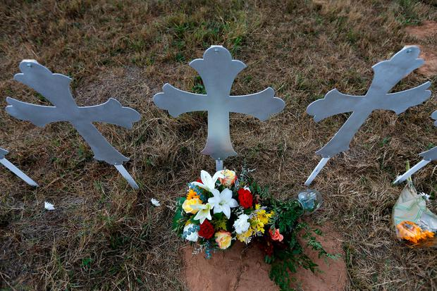 Recent mass shootings have brought the risk of gun violence into sharp focus. Pictured is a memorial to victims killed in the shooting at the First Baptist Church of Sutherland, Texas on Nov 7th Photo: Reuters/Jonathan Bachman