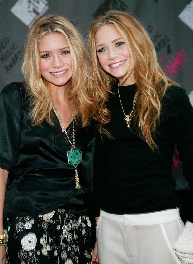 Actresses Mary Kate and Ashley Olsen arrive to the 2003 MTV Video Music Awards at Radio City Music Hall on August 28, 2003 in New York City. (Photo by Evan Agostini/Getty Images)
