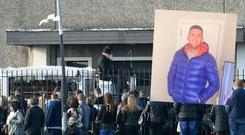 Mourners at the funeral of shooting victim Jamie Tighe Ennis (inset)