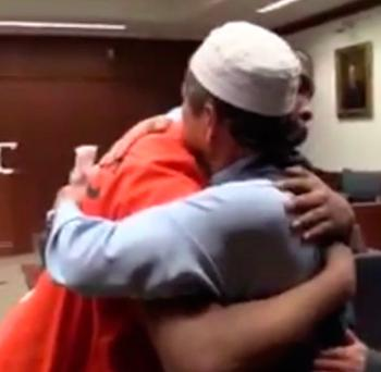Sombat Jitmoud reduced the court to tears as he hugged his son's murderer