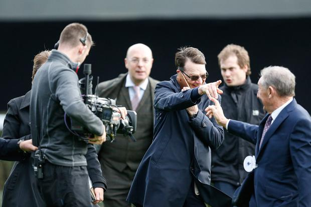 Hotline to ma: Aidan O'Brien (centre) is congratulated after equalling the world record of 25 Group One winners in a season at Ascot last month. He's since broken the record. Photo: Alan Crowhurst/Getty