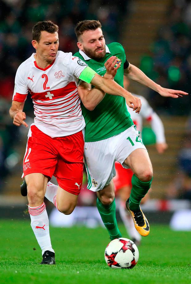 Switzerland's Stephan Lichtsteiner (left) and Northern Ireland's Stuart Dallas battle for the ball. Photo: Brian Lawless/PA