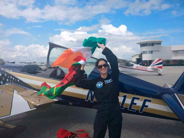 Norah proudly waves the Irish and Mayo flags before doing the high gravity flight