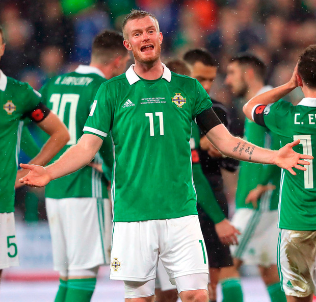 Northern Ireland's Chris Brunt reacts after Corry Evans conceded a penalty for handball during the 2018 World Cup qualifying play-off first leg match at Windsor Park, Belfast. Photo: Niall Carson/PA