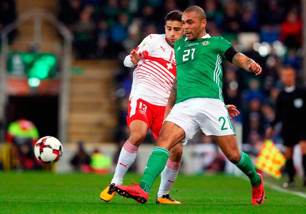 Northern Ireland's Josh Magennis (right) and Switzerland's Ricardo Rodriguez battle for the ball at Windsor Park. Photo: Brian Lawless/PA