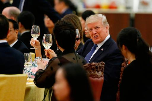 US President Donald Trump toasts with Peng Liyuan, wife of China's President Xi Jinping, a state dinner at the Great Hall of the People in Beijing. Photo: Thomas Peter/AP