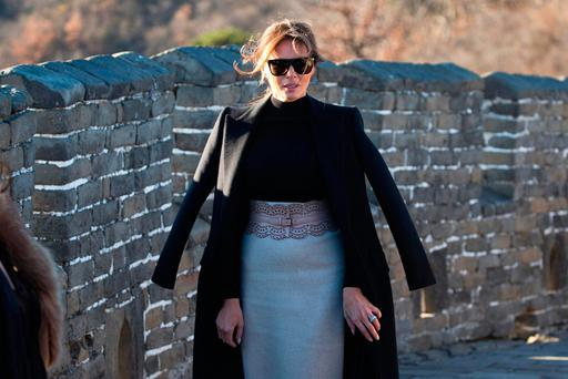 U.S. first lady Melania Trump walks along the Mutianyu Great Wall section in Beijing, China, Friday, Nov. 10, 2017. (AP Photo/Ng Han Guan)
