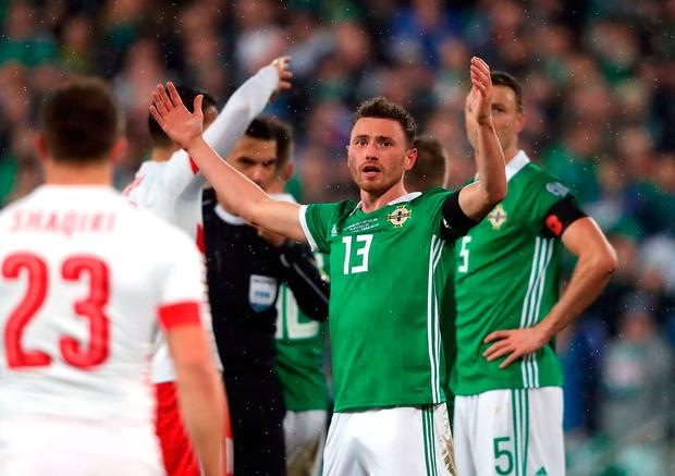 Northern Ireland's Corry Evans reacts after conceding a penalty for handball during the 2018 World Cup Qualifying Play-Off, First Leg match at Windsor Park, Belfast. Niall Carson/PA Wire.