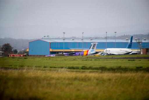 Flybe BE331 on the tarmac after it landed with no nose gear at Belfast International Airport