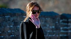 U.S. first lady Melania Trump reacts to photographers as she walks along the Mutianyu Great Wall section in Beijing, China, Friday, Nov. 10, 2017. (AP Photo/Ng Han Guan)