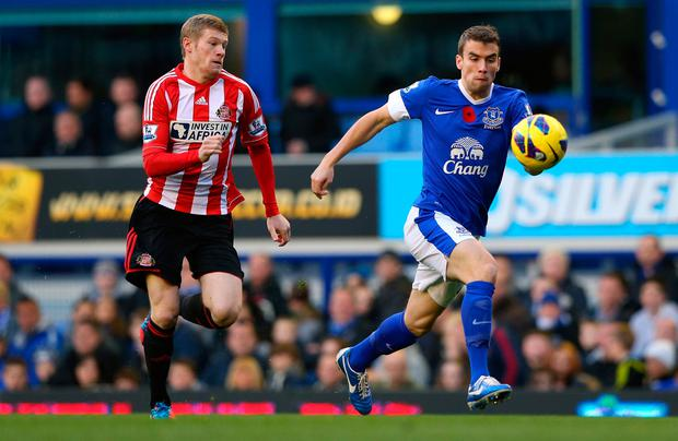 James McClean challenges Seamus Coleman during the game against Everton in November 2012 at Goodison Park, the game in which the Sunderland winger decided against wearing a poppy. Photo: Getty