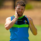 Chris Barrett applies some sun block during Ireland International Rules Squad training session at St Mary's Park in Adelaide yesterday. Photo: Sportsfile