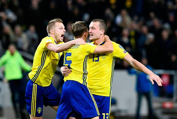 Sweden's Jakob Johansson (R) celebrates scoring his side's goal with team mates. Photo: Getty