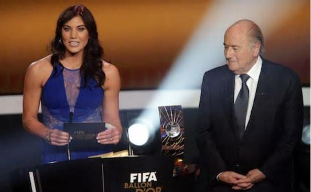 Hope Solo (L) has accused former Fifa president Sepp Blatter of sexual assault before presenting an award together at the 2013 Ballon d'Or awards Credit: Getty Images