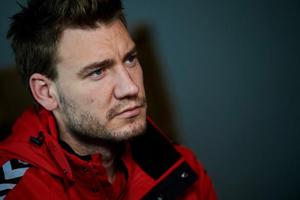 Nicklas Bendtner speaks to the media prior to the Denmark training session at Helsingor Stadion on November 7, 2017 in Helsingor, Denmark. (Photo by Lars Ronbog / FrontZoneSport via Getty Images)
