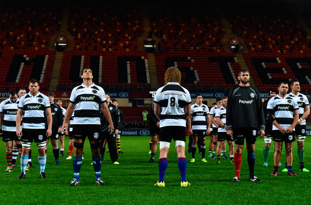 Barbarians RFC players lead by Willie Britz and Donncha O'Callaghan stand in the memory of Anthony Foley before the Representative Match between Barbarians RFC and Tonga at Thomond Park in Limerick. Photo by Matt Browne/Sportsfile