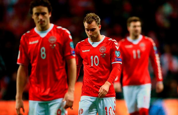 Denmark's Christian Eriksen walks off dejected after the game