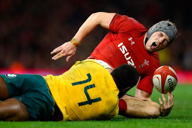 Wales' Jonathan Davies is tackled by Australia's Marika Koroibete. Photo: Getty Images