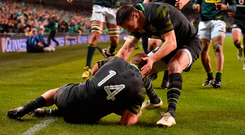 SCORE: Andrew Conway celebrates with Jonathan Sexton after scoring Ireland's first try. Photo: Matt Browne