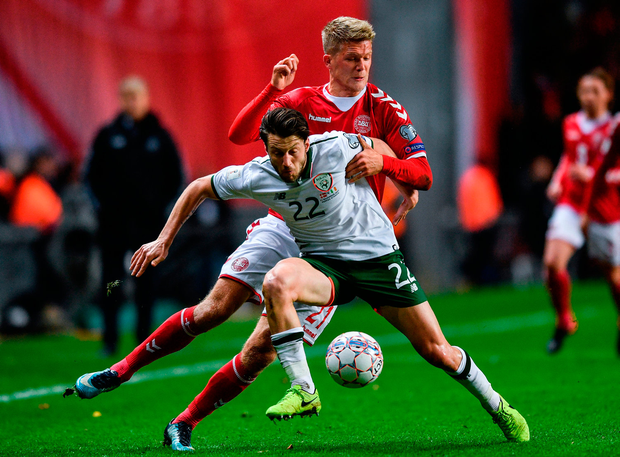 Harry Arter is shadowed closely by Denmark's Andreas Cornelius in last night's World Cup qualifier play-off in Copenhagen. Picture: Sportsfile
