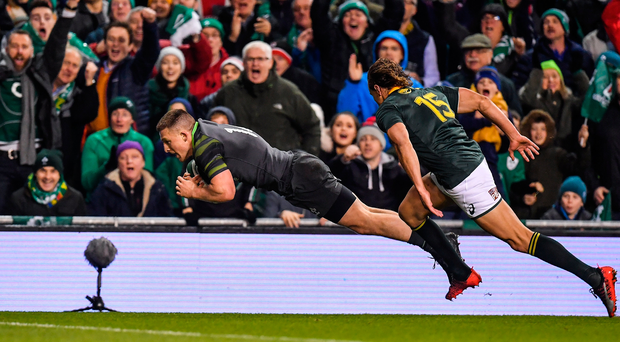 Andrew Conway scores the first of Ireland's four tries in the victory over South Africa at the Aviva Stadium last night. Photo: Sportsfile
